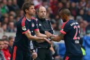 Arturo Vidal of Muenchen is substituted by his team mate Thomas Mueller (L)  during the Bundesliga match between VfB Stuttgart and FC Bayern Muenchen at Mercedes-Benz Arena on April 9, 2016 in Stuttgart, Germany.