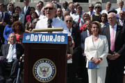 """U.S. Senate Minority Leader Sen. Harry Reid (D-NV) speaks as Vice President Joseph Biden, House Minority Leader Rep. Nancy Pelosi (D-CA) and other Senate and House Democrats listen during a press event on the House East Front Steps of the Capitol September 8, 2016 in Washington, DC. Congressional Democrats urge the Republicans to """"do your job!"""""""