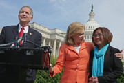 U.S. House of Representatives Victims' Rights Caucus Chairman Rep. Ted Poe (R-TX) (L) and Rep. Carolyn Maloney (D-NY) (C) hold a news conference to discuss human trafficking legislation with survivor Shandra Woworuntu outside the U.S. Capitol May 20, 2014 in Washington, DC. A native of Indonesia, Woworuntu graduated from college and worked at the Korea Exchange Bank before becoming a victim of human trafficking and sold into sexual slavery in New York City. The bipartisan lawmakers urged their colleagues to vote for The Justice for Victims of Trafficking Act and The Human Trafficking Fraud Enforcement Act of 2014.