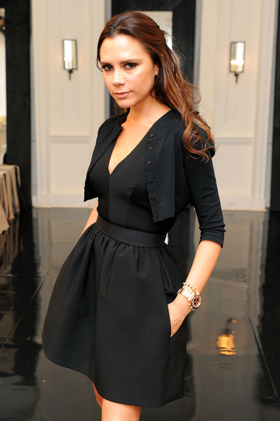 Victoria Beckham poses backstage at the Victoria Beckham Dresses Spring 2011 presentation during Mercedes-Benz Fashion Week at  on September 12, 2010 in New York City.