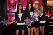 (L-R) Models Chanel Iman, Adriana Lima, Erin Heatherton and Lily Aldridge reveal their favorite holiday gift picks at Victoria's Secret, SoHo on November 22, 2010 in New York City.