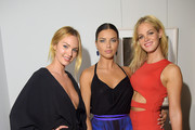"""(L-R) Models Candice Swanepoel, Adriana Lima and Erin Heatherton attend Russell James' """"Angel"""" book launch hosted by Victoria's Secret on September 10, 2014 in New York City."""