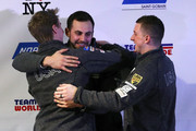 USA Olympic team nominees, from left, Tucker West, Chris Mazdzer and Taylor Morris hug during the Ice Ball at the Conference Center at Lake Placid on December 16, 2017 in Lake Placid, New York.