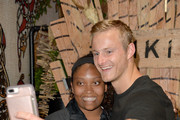 Alexander Ludwig takes a photo with a fan during the Vikings Battle Axe Training at San Diego Comic-Con 2019 on July 20, 2019 in San Diego, California.