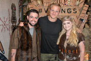 Alexander Ludwig takes a photo with fans during the Vikings Battle Axe Training at San Diego Comic-Con 2019 on July 20, 2019 in San Diego, California.