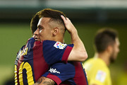 Lionel Messi of Barcelona celebrates with his teammate Neymar Jr (R) during the La Liga match between Villarreal CF and FC Barcelona at El Madrigal stadium on August 31, 2014 in Villarreal, Spain.