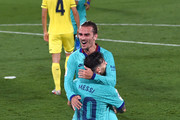 Antoine Griezmann of Barcelona celebrates after scoring his sides third goal with Lionel Messi during the Liga match between Villarreal CF and FC Barcelona at Estadio de la Ceramica on July 05, 2020 in Villareal, Spain.