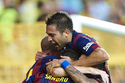 Sandro of Barcelona celebrates after scoring with his teammates Jordi Alba (R), Mathieu and Xavi during the La Liga match between Villarreal CF and FC Barcelona at El Madrigal stadium on August 31, 2014 in Villarreal, Spain.