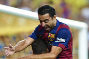 Sandro of Barcelona celebrate after scoring with his teammate Xavi (R) during the La Liga match between Villarreal CF and FC Barcelona at El Madrigal stadium on August 31, 2014 in Villarreal, Spain.