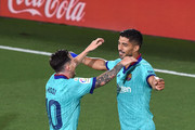 Luis Suarez of Barcelona celebrates with Lionel Messi after scoring his sides second goal during the Liga match between Villarreal CF and FC Barcelona at Estadio de la Ceramica on July 05, 2020 in Villareal, Spain.