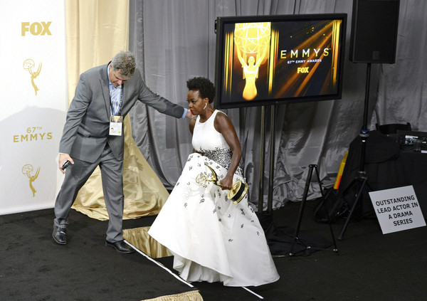 67th Annual Primetime Emmy Awards - Press Room [outstanding lead actress in a drama series,how to get away with murder,photograph,bride,wedding,ceremony,dress,yellow,wedding dress,event,gown,fashion,viola davis,stage,room,microsoft theater,press room,los angeles,california,primetime emmy awards]