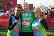 Cara Kilbey, Iwan Thomas and Billi Mucklow poses for the camera during the Virgin London Marathon 2012 on April 22, 2012 in London, England.