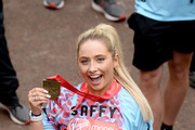 Saffron Barker finishes the Virgin London Marathon 2019 on April 28, 2019 in London, United Kingdom.