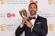 Winner of Single Documentary for 'Rio Ferdinand: Being Mum and Dad', Rio Ferdinand poses in the press room at the Virgin TV British Academy Television Awards at The Royal Festival Hall on May 13, 2018 in London, England.