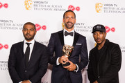 Winner of Single Documentary for 'Rio Ferdinand: Being Mum and Dad', Rio Ferdinand (C) poses with presenters Noel Clarke (L) and Ashley Walters in the press room at the Virgin TV British Academy Television Awards at The Royal Festival Hall on May 13, 2018 in London, England.