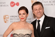 Anna Friel (L) and Sean Bean pose in the Winner's room at the Virgin TV BAFTA Television Awards at The Royal Festival Hall on May 14, 2017 in London, England.