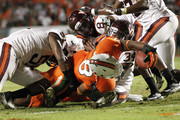 Kyshoen Jarrett #34 of the Virginia Tech Hokies is unable to stop Duke Johnson #8 of the Miami Hurricanes from scoring a touchdown in the fourth quarter on November 1, 2012 at Sun Life Stadium in Miami Gardens, Florida. The Hurricanes defeated the Hokies 30-12.