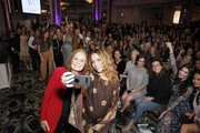 Gloria Steinem and Cleo Wade take a photo with guests during Visionary Women's celebration of Gloria Steinem in conversation with Cleo Wade at the Beverly Wilshire, A Four Seasons Hotel on November 18, 2019 in Beverly Hills, California.