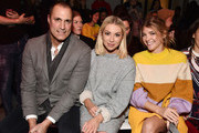 Photographer Nigel Barker, Stassi Schroeder, and Katie Sands attend the Vivienne Tam front row during New York Fashion Week: The Shows at Gallery I at Spring Studios on February 13, 2018 in New York City.