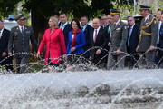 Austrian Foreign Minister Karin Kneissl, Austrian undersecretary in the interior ministry Karoline Edtstadler and Russian President Vladimir Putin take part in a wreath laying ceremony at the Soviet war memorial at Schwarzenbergplatz in Vienna on June 5, 2018 in Vienna, Austria. Putin is in Vienna to commemorate the 50th anniversary of the completion of a pipeline that transports Russian gas to Europe.