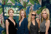 Kimberley Mens, Charlotte Cordes, Paris Hilton and Nicky Hilton attend Vladimir Restoin Roitfeld And Hilary Rhoda Attend L'Eden By Perrier-Jouet To Celebrate Launch Of CR WOMEN 2019 at Faena Beach on December 6, 2018 in Miami Beach, Florida.