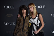 Mica Arganaraz and Lexi Boling attends the Vogue 95th Anniversary Party on October 3, 2015 in Paris, France.