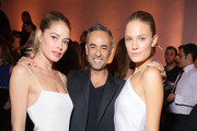 (L-R) Doutzen Kroes, Francisco Costa and Constance Jablonski attend Vogue 95th Anniversary Party on October 3, 2015 in Paris, France.