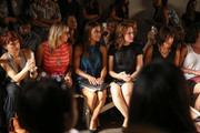 (2L-R) Designer / TV personality Nikki Poulos, actress Toni Trucks and Amy Trucks attend the Voz fashion show during Mercedes-Benz Fashion Week Spring 2014 at Eyebeam on September 12, 2013 in New York City.