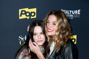 Actors Emily Hampshire (L) and Annie Murphy attend the 'Schitt's Creek' panel, part of Vulture Festival LA presented by AT&T at Hollywood Roosevelt Hotel on November 19, 2017 in Hollywood, California.