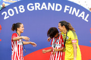 Lauren Barnes, Yukari Kinga and Lydia Williams of Melbourne City celebrate victory during the W-League Grand Final match betweenSydney FC and Melbourne City FC at Allianz Stadium on February 18, 2018 in Sydney, Australia.