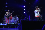 "(L-R) Bassist Michael ""Flea"" Balzary, drummer Chad Smith and lead singer Anthony Kiedis of Red Hot Chili Peppers perform onstage at WFANs Big Hello To Brooklyn at Barclays Center of Brooklyn on February 1, 2014 in New York City."