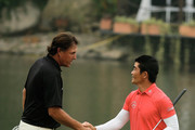 Liang Wen-chong of China (R) shakes hands with Phil Mickelson of the USA on the 18th hole during the final round of the WGC-HSBC Champions at the Sheshan International Golf Club on November 3, 2013 in Shanghai, China.