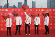 Martin Kaymer of Germany (C) hangs a Chinese lantern as Justin Rose of England, Bubba Watson and Rickie Fowler of the United States, Adam Scott of Australia look on, at the Peninsula Hotel prior to the start of the WGC - HSBC Champions on November 4, 2014 in Shanghai, China.