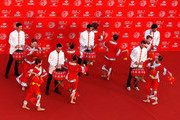 Justin Rose of England, Rickie Fowler of the United States, Adam Scott of Australia, Martin Kaymer of Germany and Bubba Watson of the United States are seen with local dancers atop the Peninsula Hotel prior to the start of the WGC - HSBC Champions on November 4, 2014 in Shanghai, China.