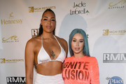 WNBA player Liz Cambage (L) of the Las Vegas Aces and rapper Iggy Azalea attend the WNBA All-Star Game 2019 beach concert at the Mandalay Bay Beach at Mandalay Bay Resort and Casino on July 26, 2019 in Las Vegas, Nevada.