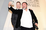 Sir Nicholas Serota presents Ai Wi Weiwei with an award at the WSJ Magazine 2016 Innovator Awards at Museum of Modern Art on November 2, 2016 in New York City.