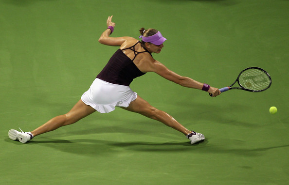 Vera Zvonareva of Russia returns a shot to Victoria Azarenka of Belarus during day two of the WTA Championships at the Khalifa Tennis Complex on October 27, 2010 in Doha, Qatar.