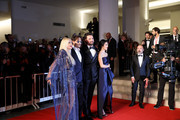 """(L-R) Monika Bacardi, Mark Rylance, Johnny Depp, Andrea Iervolino and Olga Segura walk the red carpet ahead of the """"Waiting For The Barbarians"""" screening during the 76th Venice Film Festival at Sala Grande on September 06, 2019 in Venice, Italy."""