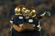 Manti T'eo #5 of the Notre Dame Fighting Irish (R) hugs teammate Louis Nix III #9 as he leaves the home field for the last time during a game against the Wake Forest Demon Deacons at Notre Dame Stadium on November 17, 2012 in South Bend, Indiana. Notre Dame defeated Wake Forest 38-0.
