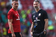 Ryan Giggs manager of Wales talks to Aaron Ramsey during a training session a the Racecourse Ground on May 21, 2018 in Wrexham, Wales.