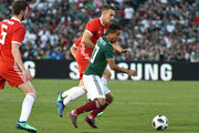 Giovani Dos Santos #10 of Mexico is pressured by Aaron Ramsey #10 of Wales during the second half of their friendly international soccer match at the Rose Bowl on May 28, 2018 in Pasadena, California.