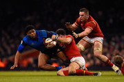 Jonathan Danty of France is hauled down by Jamie Roberts and Dan Lydiate of Wales during the RBS Six Nations match between Wales and France at the Principality Stadium on February 26, 2016 in Cardiff, Wales.