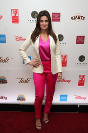 Idina Menzel balanced out her loud colors with a cream blazer.