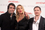 """(L-R) Director Christian Molina, actress Valeria Marini and actor Ben Temple attend the """"I Want To Be  A Soldier"""" photocall during the 5th International Rome Film Festival at Auditorium Parco Della Musica on November 2, 2010 in Rome, Italy."""