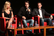 """(L-R) Actress Valeria Marini, director Christian Molina and actor Ben Temple speak on stage at the """"I Want To Be  A Soldier"""" press conference during the 5th International Rome Film Festival at Auditorium Parco Della Musica on November 2, 2010 in Rome, Italy."""