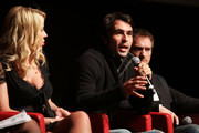 """Actress Valeria Marini, director Christian Molina and actor Ben Temple speak on stage at the """"I Want To Be  A Soldier"""" press conference during the 5th International Rome Film Festival at Auditorium Parco Della Musica on November 2, 2010 in Rome, Italy."""