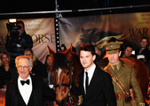 Director Steven Spielberg (L) and actor Jeremy Irvine (R) attend the UK premiere of War Horse at the Odeon Leicester Square on January 8, 2012 in London, England.