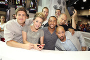 In this handout photo provided by WBTV - (L-R) Veronica Mars actors Chris Lowell, Tina Majorino, Ryan Hansen, Percy Daggs III, Francis Capra and Enrico Colantoni take a group shot with executive producer Rob Thomas during the 2013 San Diego Comic-Con International held at the  San Diego Convention Center on July 19, 2013 in San Diego, California.