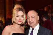 Rita Ora (L) and Warner Music Group owner Len Blavatnik attend the Warner Music Group Pre-Grammy Party in association with V Magazine on January 25, 2018 in New York City.