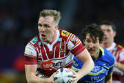 Dan Sarginson of Wigan Warriors breaks past Stefan Ratchford of Warrington Wolves during the First Utility Super League Final between Warrington Wolves and Wigan Warriors at Old Trafford on October 8, 2016 in Manchester, England.